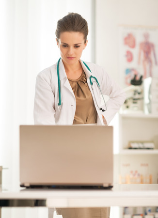 topicality: Medical doctor woman looking in laptop Stock Photo