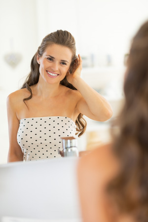Portrait of happy young woman in bathroom Stock Photo - 29382392
