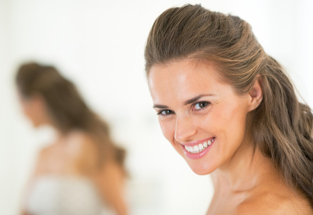 Portrait of smiling young woman in bathroom Stock Photo - 29382396