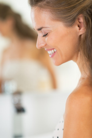 Portrait of happy young woman in bathroom Stock Photo - 29382398