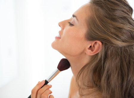 Portrait of young woman applying makeup Stock Photo - 29004539
