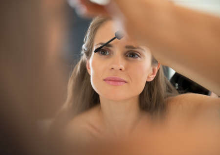 Portrait of young woman applying mascara Stock Photo - 29305264