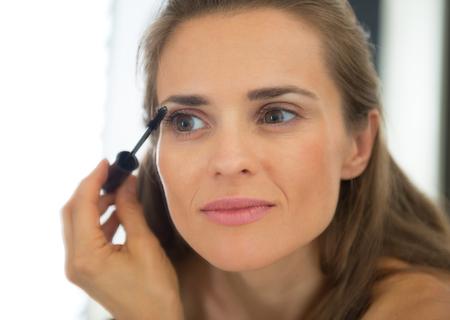 Portrait of young woman applying mascara Stock Photo - 29305265