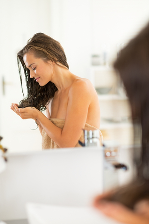 Young woman with wet hair looking on ends Stock Photo - 29043677