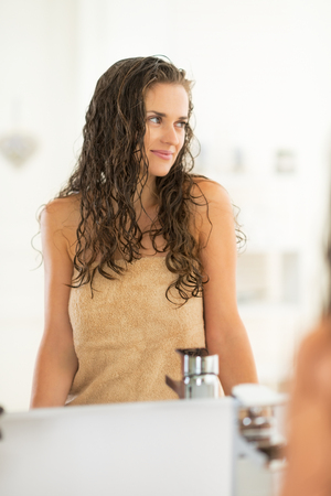 Portrait of young woman with wet hair in bathroom Stock Photo - 29043679