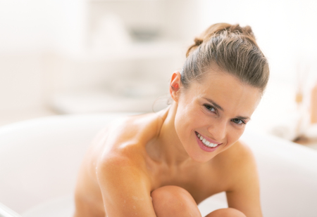 Portrait of young woman in bathtub photo