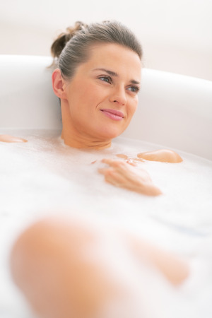 Young woman laying in bathtub Stock Photo - 29325147