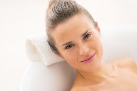 Portrait of young woman relaxing in bathtub Stock Photo - 29325151