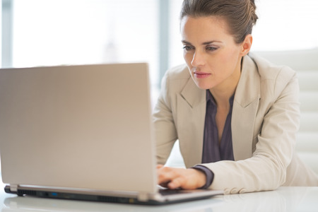 Business woman working on laptop in office Stock Photo - 29947688