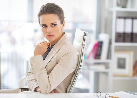 disquieted: Portrait of concerned business woman in office