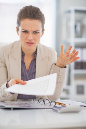 Portrait of frustrated business woman at work Stock Photo - 29947772