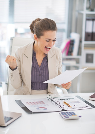 Portrait of happy business woman at work Stock Photo - 29947773