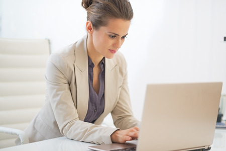 Business woman working on laptop in office Stock Photo - 29996958