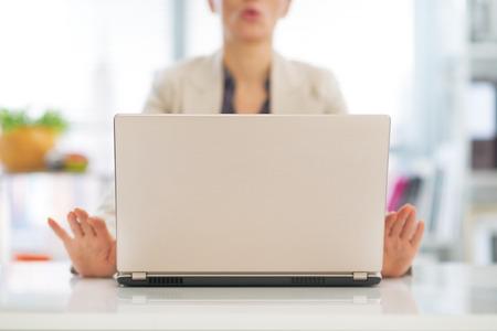 Closeup on business woman meditating near laptop Stock Photo - 29996972