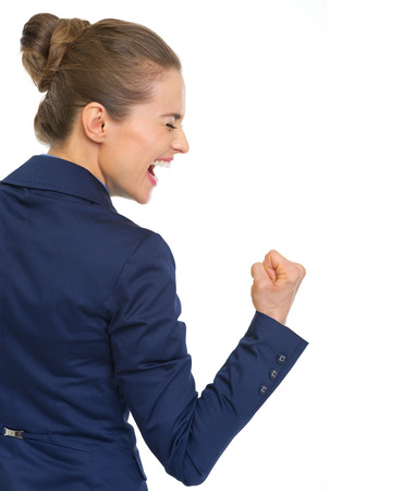 Happy business woman showing fist pump gesture