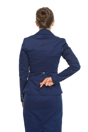Business woman holding crossed fingers behind back photo