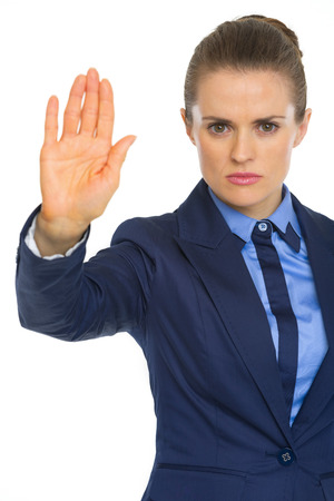 Serious business woman showing stop gesture photo
