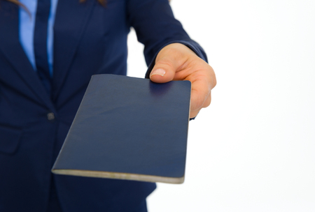 Closeup on business woman giving passport Stock Photo - 30683840
