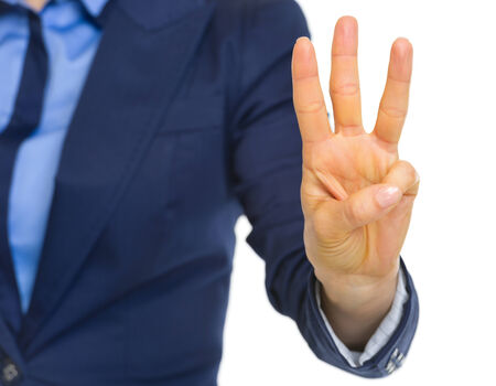 Closeup on business woman showing 3 fingers Stock Photo - 30109399