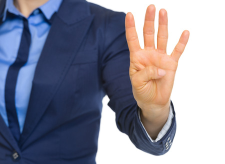 Closeup on business woman showing 4 fingers Stock Photo - 30109488