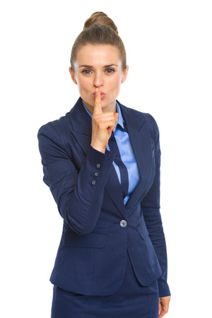 Business woman showing shh gesture Stock Photo - 30666681