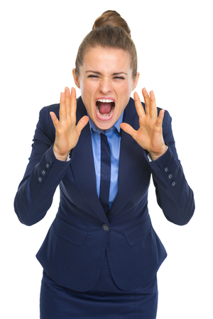 Angry business woman shouting through megaphone shaped hands Stock Photo - 30666691