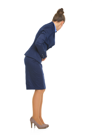 Full length portrait of business woman with stomach ache photo