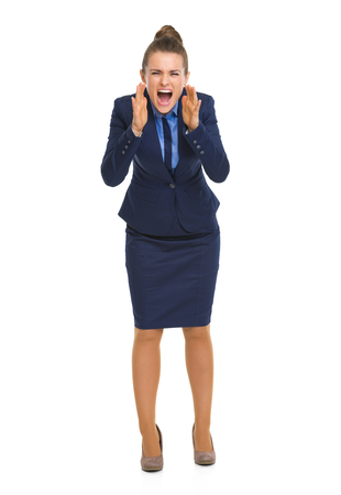 Full length portrait of angry business woman shouting through megaphone shaped hands Stock Photo - 30674923