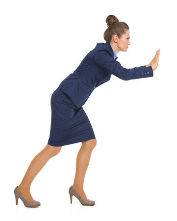 Full length portrait of business woman pushing something in front of her Stock Photo - 30674940