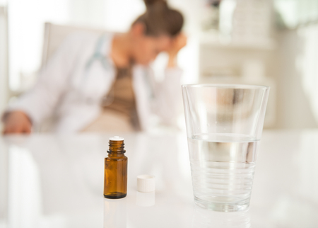 Closeup on antidepressant on table and doctor woman in background photo