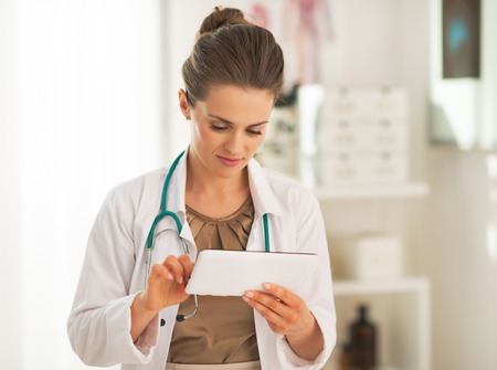 topicality: Doctor woman using tablet pc in office