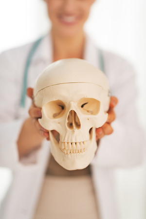 Closeup on doctor woman showing human skull Stock Photo - 30972941