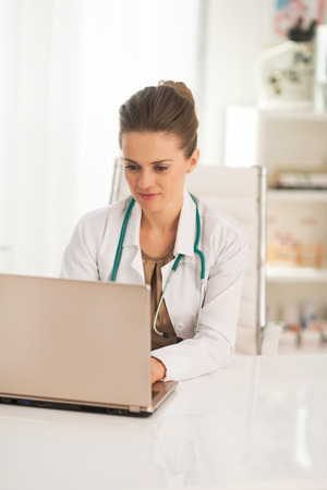 Doctor woman working on laptop