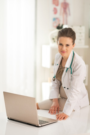 Doctor woman with laptop in office Stock Photo