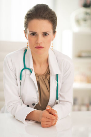 certitude: Portrait of confident doctor woman in office