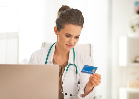 card making: Doctor woman with credit card making online shopping Stock Photo