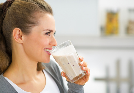 Profile portrait of happy young woman drinking fresh smoothie Zdjęcie Seryjne