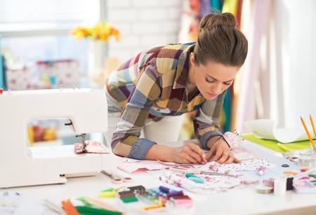 Dressmaker woman at work in studio Foto de archivo
