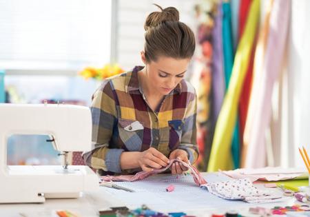 Tailor woman working in studio photo