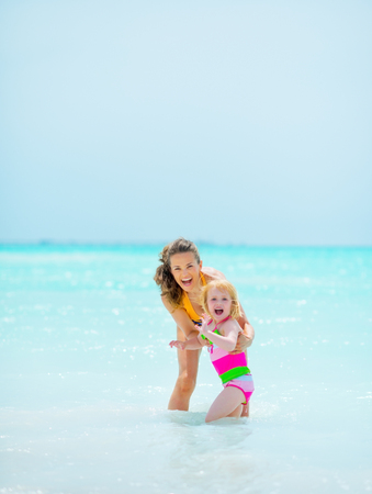 Portrait of mother and baby girl at seaside photo