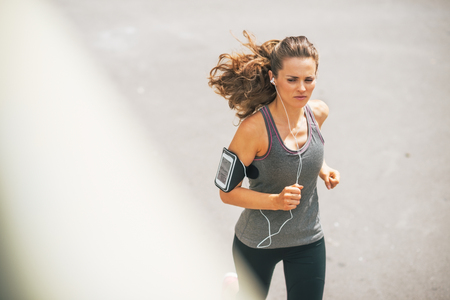 Fitness young woman jogging outdoors in the city