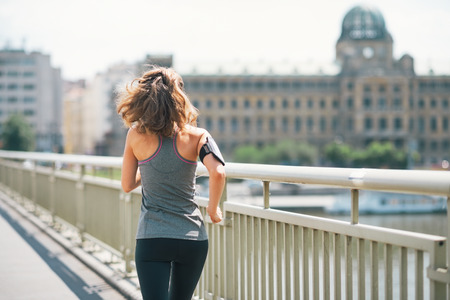 Fitness young woman jogging in the city. rear view Stock Photo