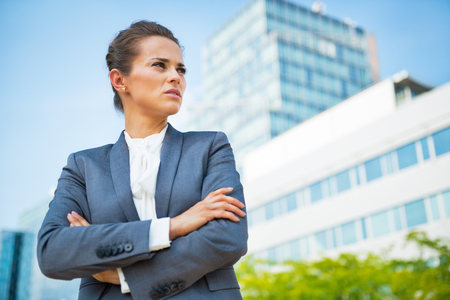 authoritative woman: Portrait of confident business woman in front of office building Stock Photo