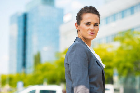 Portrait of confident business woman in office district Banco de Imagens