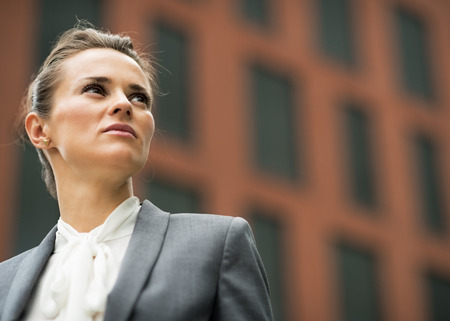 Portrait of confident business woman in front of office building Banco de Imagens