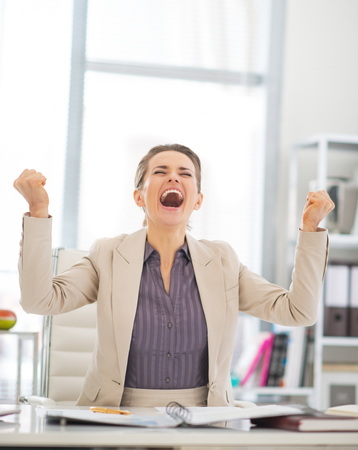 felicity: Happy business woman rejoicing in office