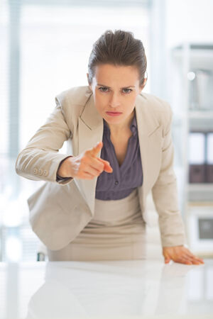 disquieted: Concerned business woman pointing in camera Stock Photo