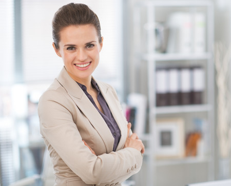 executive woman: Portrait of smiling business woman in modern office Stock Photo