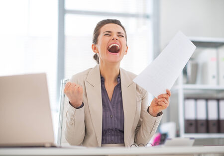 rejoicing: Happy business woman in office rejoicing