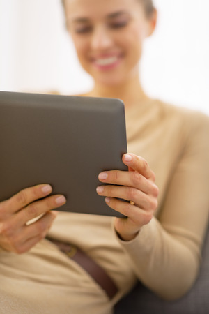 topicality: Closeup on young woman using tablet pc
